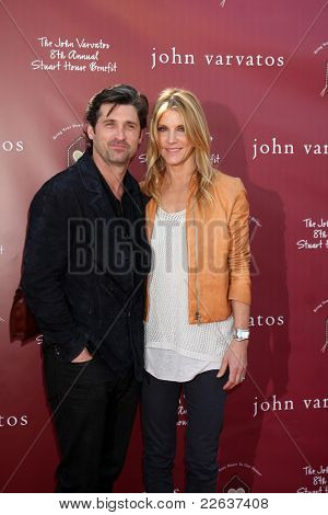LOS ANGELES - MAR 13:  Patrick Dempsey, wife Jill Fink Dempsey arriving at the John Varvatos 8th Annual Stuart House Benefit at John Varvaots Store on March 13, 2011 in Los Angeles, CA