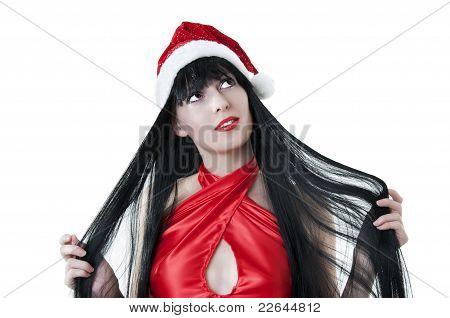 Portrait Of Female Model In Red Santas Cap