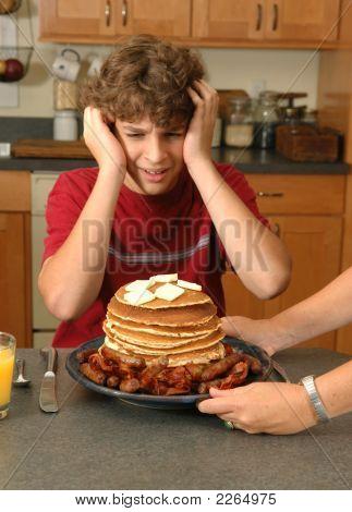 Boy Horrified By Enormous Breakfast