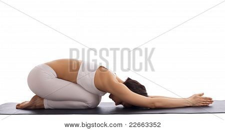 woman in white dress sit on rubber mat - yoga pose