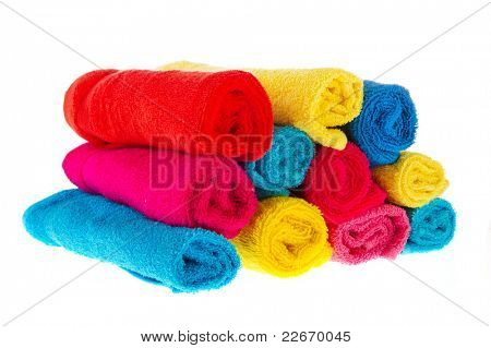 Many colorful rolled towels isolated over white background