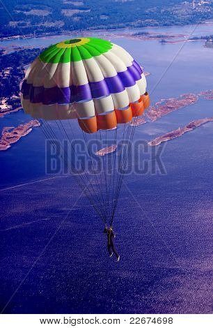 Parachutist against the background of natural landscape