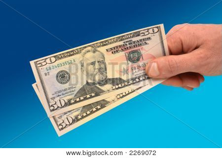 Hand Holding $50 Banknote
