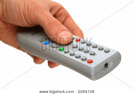 A Remote Control Panel By The Tv