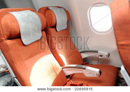 orange seats in airplane cabin of airbus 330
