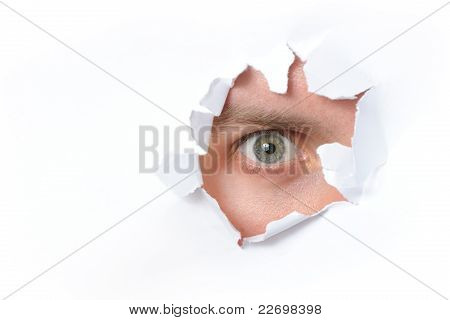 Eye Looking Through A Hole In Paper