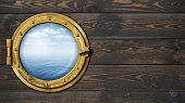 ship or boat with ocean horizon porthole on wooden wall poster
