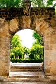 Arch of stone in entrance to Hort del Rei gardens Palma de Mallorca near Almudaina