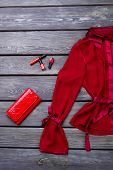 Ladies Red Elegant Blouse. Set Of Women Beautiful Red Shirt, Purse And Cosmetics On Old Wooden Backg poster