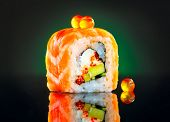 Sushi roll japanese food over black background. California Sushi roll with salmon, vegetables, flyin poster