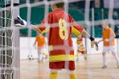 Football Futsal Training For Children. Indoor Football Goalkeeper Standing In Goal. Indoor Soccer Yo poster