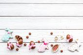 Celebrate Easter. Modern Signs Of Easter. Chocolate Easter Eggs And Easter Bunny Cookies. White Wood poster