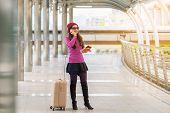 Woman Traveller Using Smartphone. Travel Concept. poster