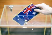 Man Inserting Flag Of Australia Into Ballot Box, Voting And Elections In Australia. poster