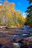 picture of caribou  - looking up the fast flowing water of caribou creek autumn in northern minnesota - JPG