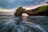 Sunset Near Famous Tourist Landmark Of Bali Island - Tanah Lot & Batu Bolong Temple. Long Exposure E poster
