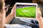 Man Watching Sports On Tablet. Football And Soccer Game Live Stream And Video Player On Screen. Pay  poster