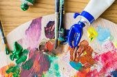 fine art, creativity, painting and artistic tools concept - close up of acrylic color or paint tubes poster