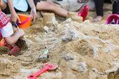 Children Are Learning Dinosaur Remains, Excavating Dinosaur Fossils Simulation In The Park. poster