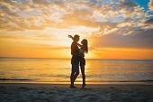 Couple On Beach At Sunset Summer Vacation, Beautiful Young People In Love Walking, Man Woman Holding poster