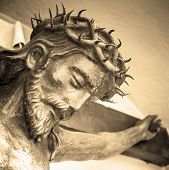 The Suffering Of Jesus Christ. Details Of The Bronze Statue. Sepia Tone. poster