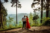 Romantic Outdoor Full-length Portrait. Attractive Couple Is Tenderly Looking At Each Other With The  poster