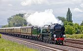 image of loco  - Mainline steam loco taking paying passengers to the coast in extremely high class carriages - JPG