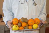 Slim Down Dieting Concept. Doctor In White Lab Coat Recommending Healthy Food. Doctor Specialist Die poster