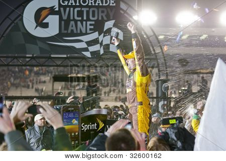 RICHMOND, VA - APRIL 28:  Kyle Busch (18) holds off a hard charging field to win the Capital City 400 at the Richmond International Raceway in Richmond, VA on April 28, 2012.