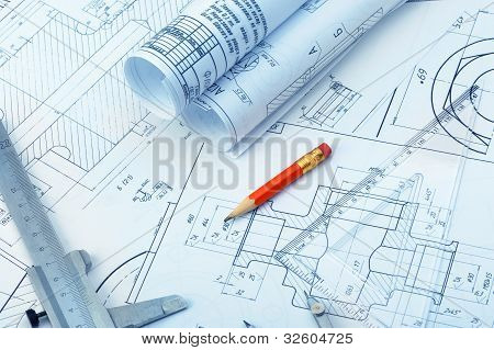 The Plan Industrial Details, A Ruler, Caliper, Divider And A Red Pencil.