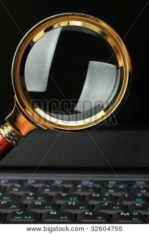 Magnifying Glass And A Laptop