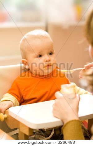 Feeding A Little Baby Boy