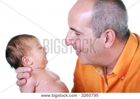 Father Holding His Precious Newborn Child