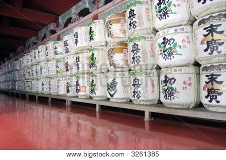 Barrels Of Sake Wine In Japanese Temple