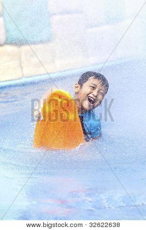 Happy Asian Kid At Swimming Pool