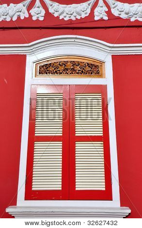Old window with red color