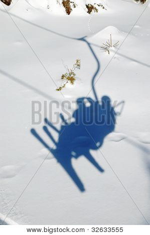 Ski Chairlift With Skiers Shadow
