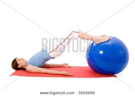 Young Woman Performing Fitness Exercises