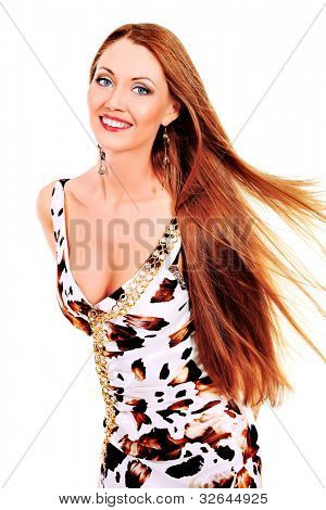 Fashionable young woman in beautiful dress posing at studio. Isolated over white.