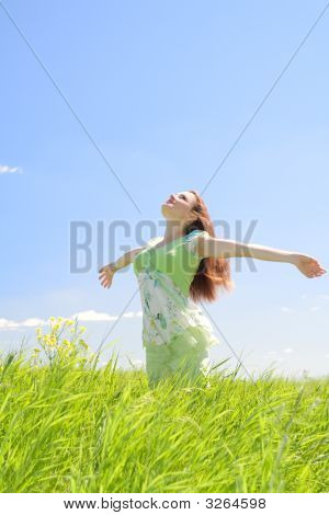 Beautiful Woman In Green Field