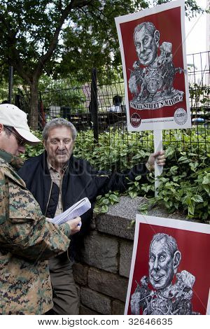 NEW YORK - MAY 1: A protester in Union Square holds a sign depicting Michael Bloomberg as