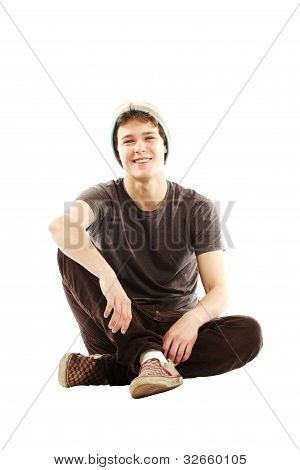 Young Man Dressed With Hip Style Sitting Cross Legged