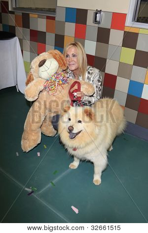 LOS ANGELES, CA - MAY 3: Joan Van Ark, dog Goldie at the grand opening of the Pooch Hotel on May 3, 2012 in Hollywood, Los Angeles, California.