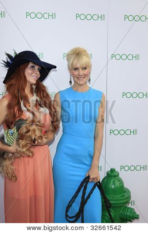 LOS ANGELES, CA - MAY 3: Phoebe Price, Robin Tomb at the opening of the Pooch Hotel on May 3, 2012 in Hollywood, Los Angeles, CA. The Pooch Hotel is a luxury hotel and daycare exclusively for dogs.