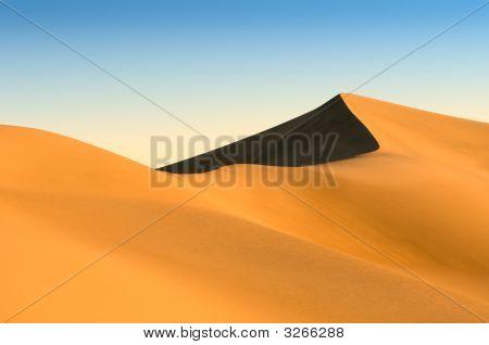 Sand Dunes Over Blue Sky