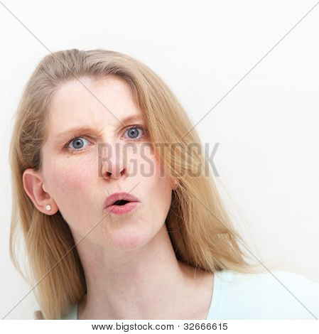 Young Woman Showing Mild Shock After Hearing News