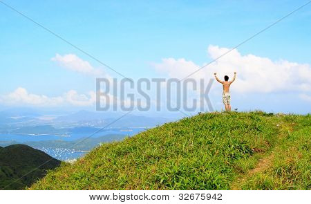 Beautiful mountains landscape with lake in hongkong and man on the top
