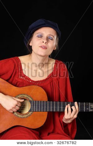 Woman Playing the Guitar and Singing