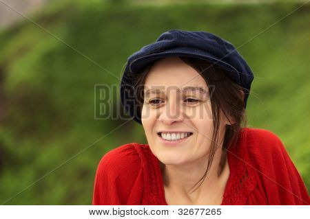 Smiling Woman with Cap