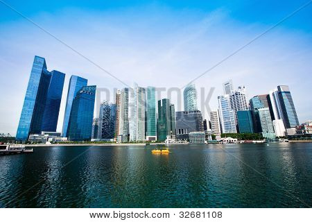 Skyscrapers of Marina Bay - business district in Singapore .